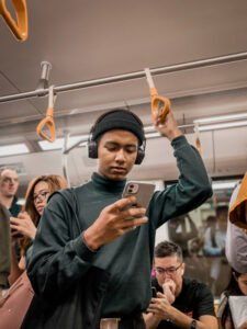 photo of people on public transport all looking at their smartphones